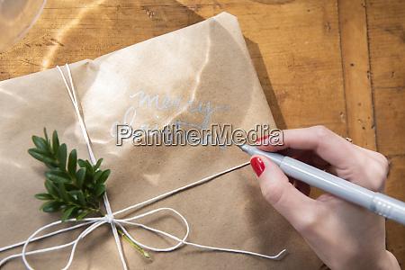 hand of woman writing on christmas