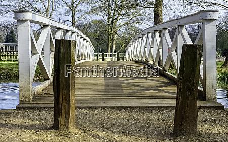 wooden bridge over octagon lake in