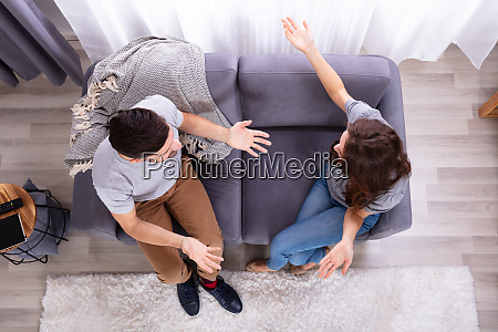 aggressive wife fighting with his husband