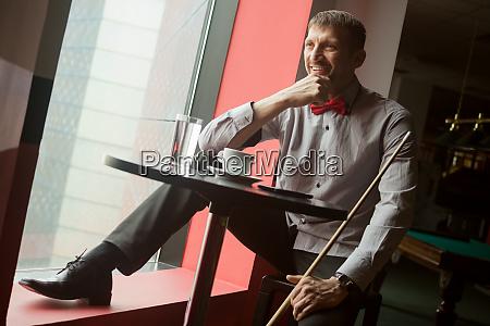 smiling billiard player