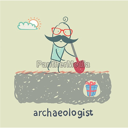 archaeologist stands on the spot where