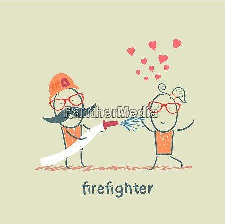 firefighter extinguishes a girl who fell