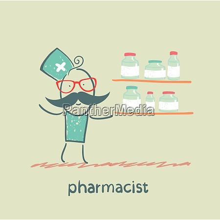 pharmacist standing next to a shelf