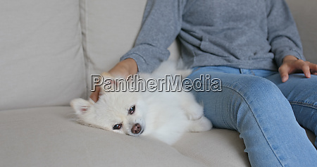 woman cuddle her dog at home