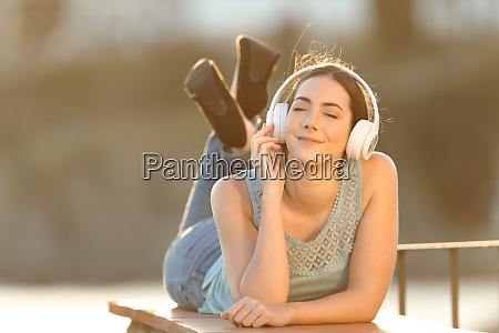 woman enjoying listening to music in