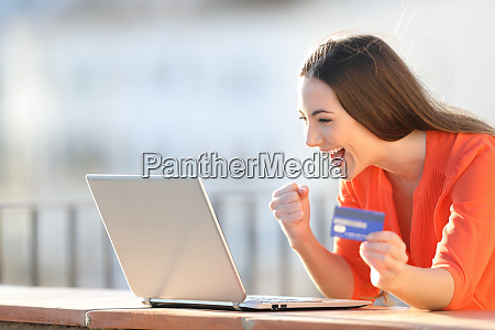 excited buyer finding online offers on