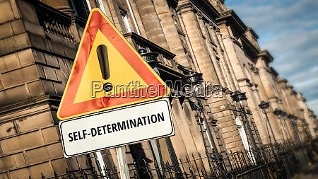 street sign to self determination