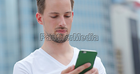 caucasian young man use of mobile