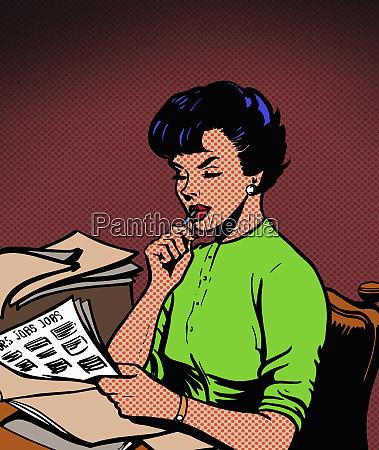 beautiful woman reading job ads
