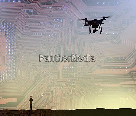man flying drone in circuit board