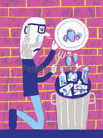 man throwing food away
