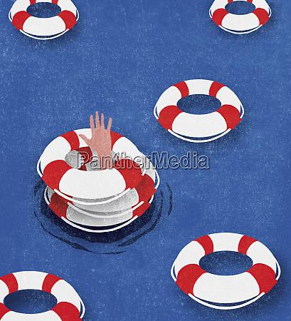man sinking despite three life belts