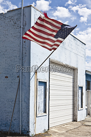 american flag on an abandoned building