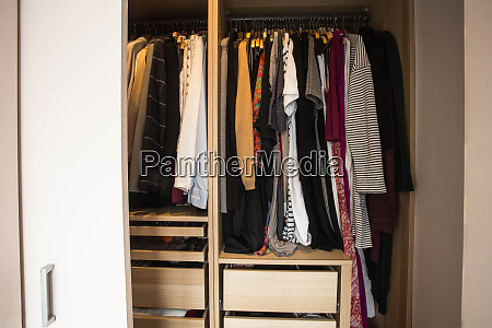 wardrobe with messy clothes closeup fashion