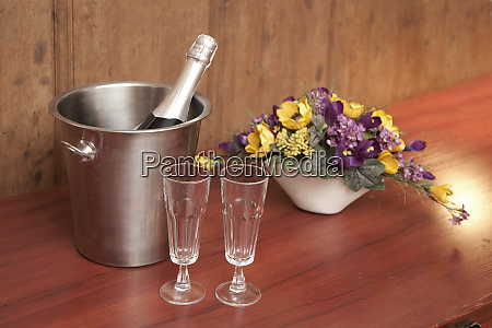 bucket with champagne and two glasses
