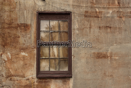 window in stucco wall