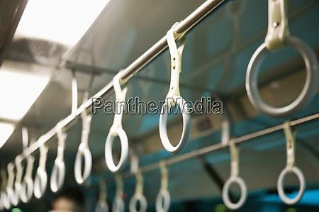 handles on mass transit vehicle