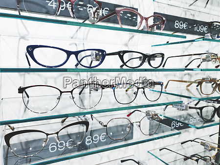 shelf with glasses in eyewear store