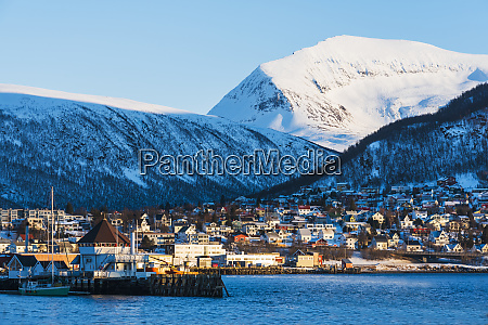 town under snow covered mountains in
