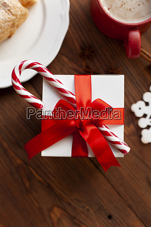 christmas present with red ribbon and