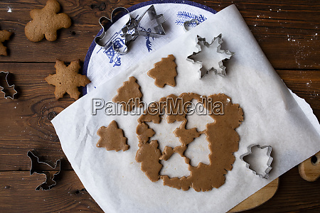 cookie dough with cut out shapes