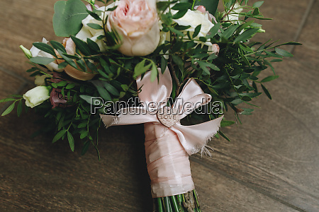 wedding bouquet tied with pink ribbon
