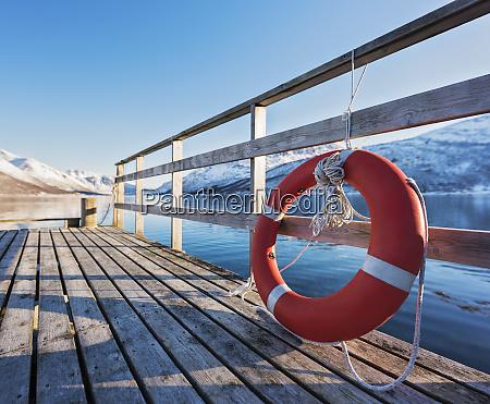 life, preserver, on, pier, in, tromso, - 26810164