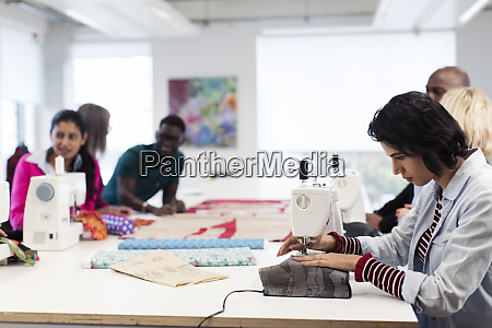 fashion design students working at sewing
