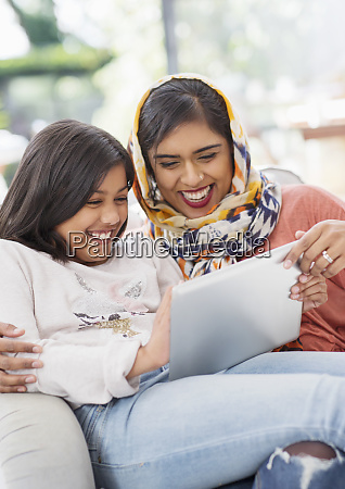 laughing happy mother in hijab and