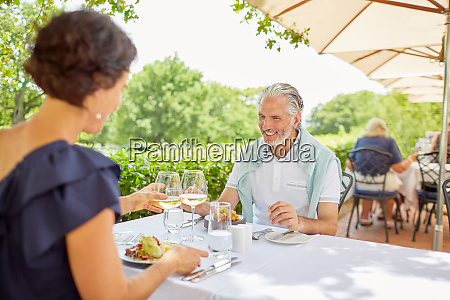 mature couple dining at patio table