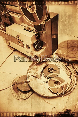 old film reels on a wooden