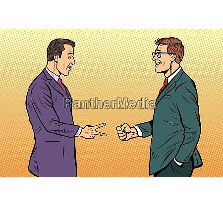 businessmen game rock paper scissors