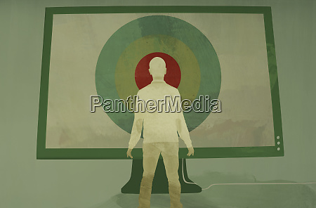 man standing in front of large