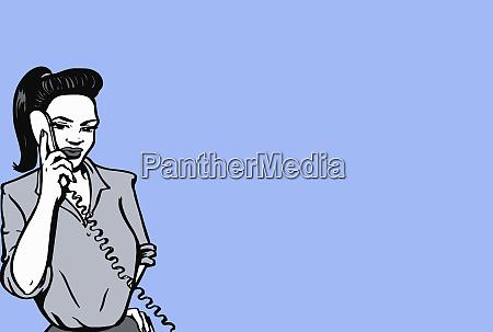 woman talking on landline phone
