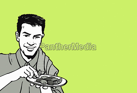 man serving plate of hors doeuvres