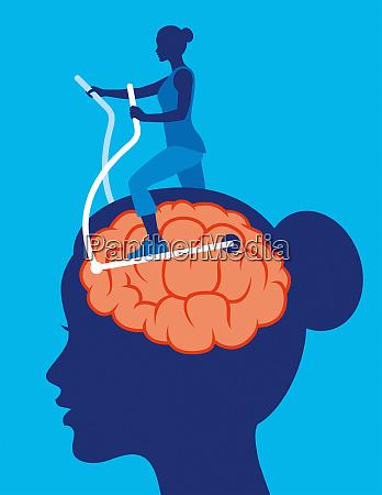 woman exercising brain using cross trainer