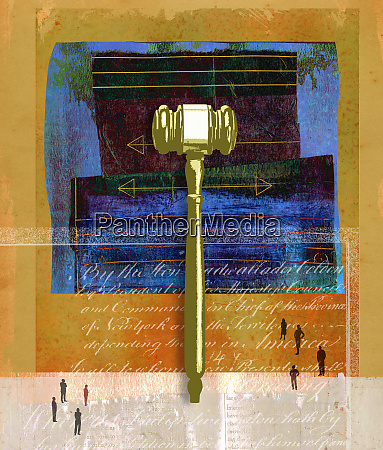 people looking at large gavel over
