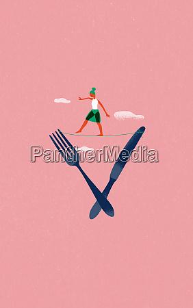 woman balancing on tightrope between knife