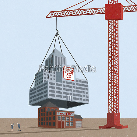 crane installing bigger company over smaller
