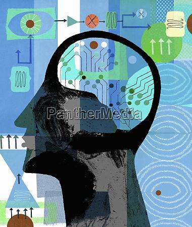 man with circuit board brain making