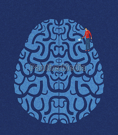 man shining torch in brain maze