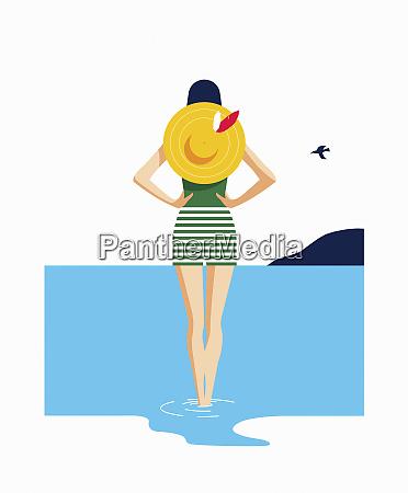 woman at seaside paddling in water