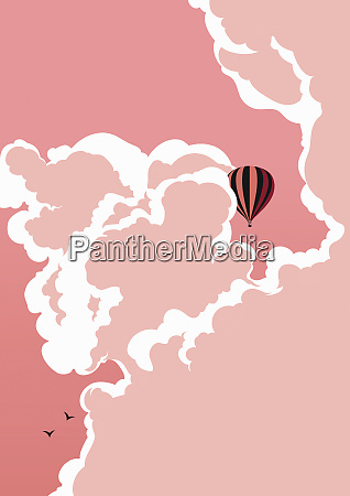hot air balloon floating in pink