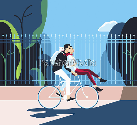 happy couple riding bike together