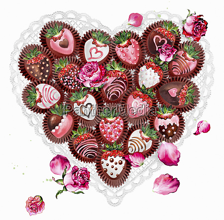 decorated chocolate coated strawberries in heart