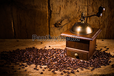 old coffee grinder with fresh roasted