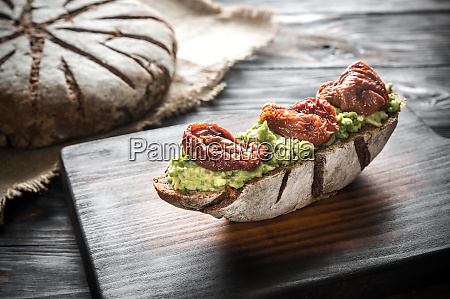 sandwich with guacamole and sun dried