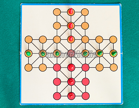 top view of cross solitaire board