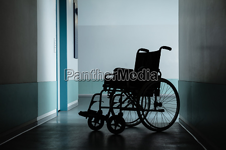 empty wheel chair in hospital corridor