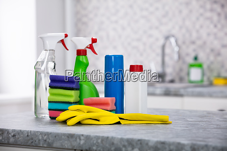 cleaning supplies on the kitchen countertop